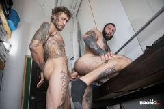 Bearded-muscle-man-Markus-Kage-knees-sucks-Bo-Sinn-huge-dick-Bromo-001-gay-porn-pics