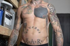 Bearded-muscle-man-Markus-Kage-knees-sucks-Bo-Sinn-huge-dick-Bromo-007-gay-porn-pics