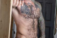 Bearded-muscle-man-Markus-Kage-knees-sucks-Bo-Sinn-huge-dick-Bromo-014-gay-porn-pics