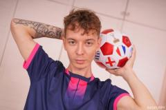 Young-soccer-player-Christian-Hermes-strips-football-kit-wanking-huge-uncut-cock-Bad-Puppy-3-porno-gay-pics